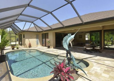 DM Dean Custom Built Home with Screened Pool and dolphin statue