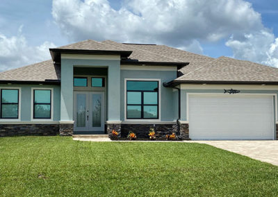 DM Dean Custom Built Coastal Style Model Home 2098 painted gray-blue with white accents