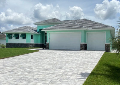 DM Dean Custom Built Coastal Style Model Home 2098 painted in pistachio with white accents