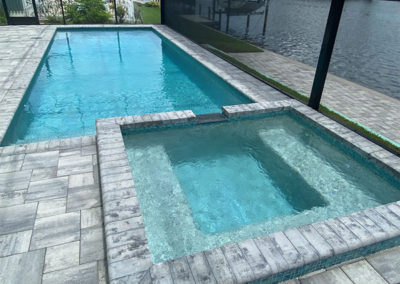 DM Dean Custom Built Pool Home with built-in tile hot tub that flows into the pool