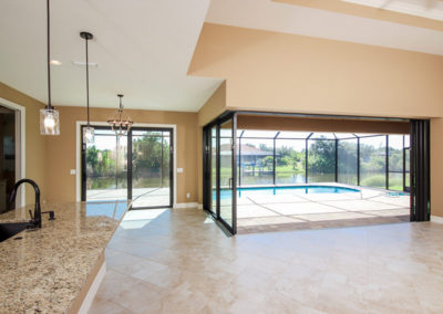 DM Dean Custom Homes, Full glass doors, coffered Living Room ceiling, custom lighting