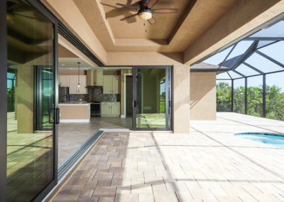 DM Dean Custom Home, Full glass doors connect indoor to outdoor living
